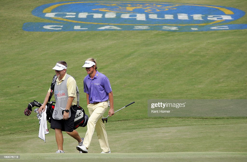John Peterson walks to the 17th green during the final round of the Chiquita Classic in the Web.com tour finals at River Run Country Club on September 8, 2013 in Davidson, North Carolina.