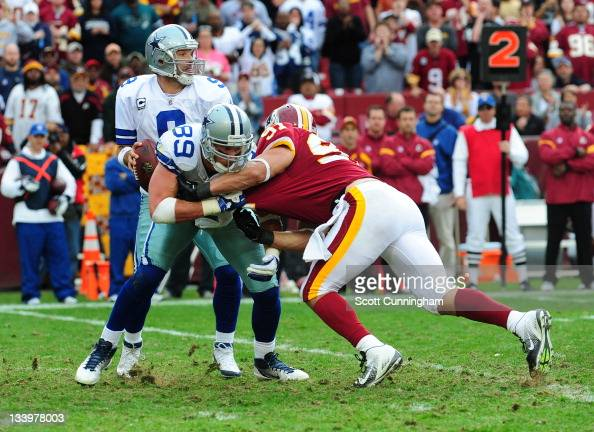 John Phillips of the Dallas Cowboys blocks against Ryan Kerrigan of the Washington Redskins at FedEx Field on November 20 2011 in Landover Maryland...