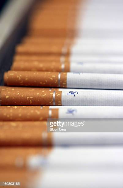 John Player Special cigarettes manufactured by Imperial Tobacco Group Plc sit stacked ahead of packaging at the company's factory in Nottingham UK on...