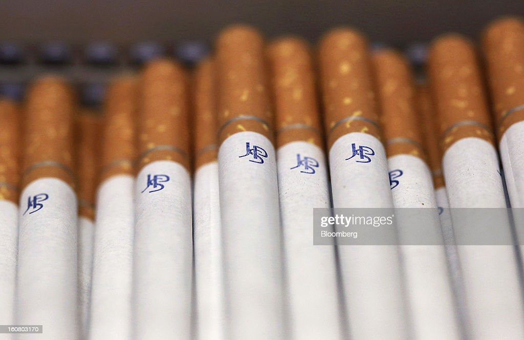 John Player Special (JPS) cigarettes, manufactured by Imperial Tobacco Group Plc, sit stacked ahead of packaging at the company's factory in Nottingham, U.K., on Friday, Feb. 1, 2013. Imperial Tobacco Group Plc is Europe's second-biggest tobacco company and generates about 40 percent of its profit from the region. Photographer: Chris Ratcliffe/Bloomberg via Getty Images