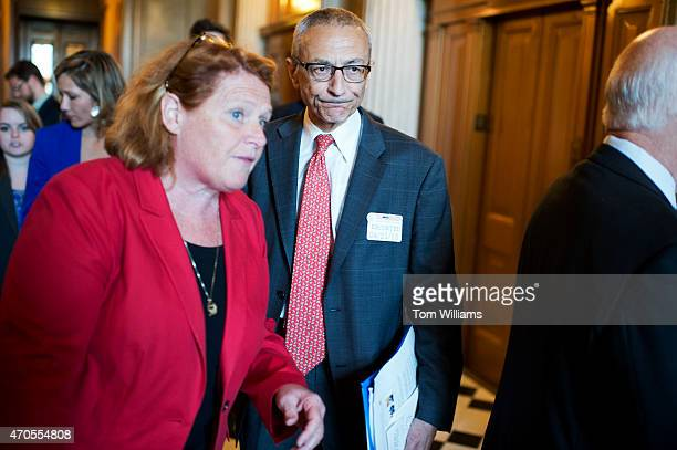 John Podesta chairman of Hillary Clinton's 2016 presidential campaign talks with Sen Heidi Heitkamp DND before the senate policy luncheons in the...