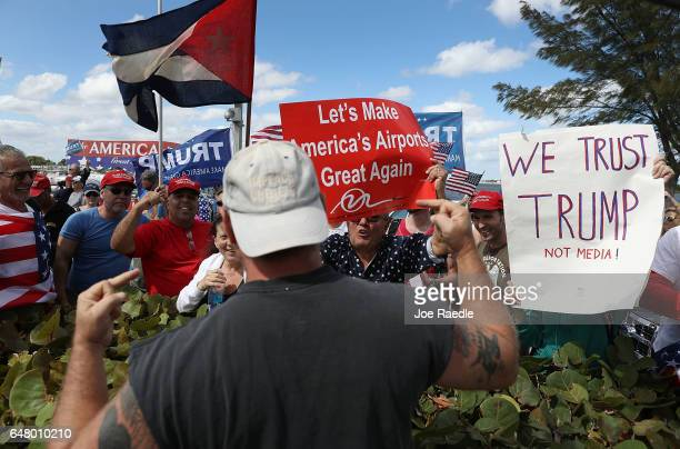 John Pope flips his middle fingers toward supporters of President Donald Trump as he expresses his disagreement with the supporters near the MaraLago...