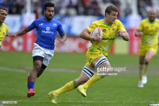 John Porch of Australia runs with ball during the HSBC rugby sevens match between Australia and Samoa on May 13 2017 in Paris France