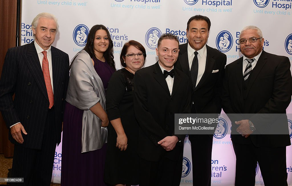 John Quinones, attends the 4th Annual Milagros para Ninos Gala benefitting Boston Children's Hospital with Dr. Patricio Vives (L), Eduardo Martinez, Jr. (3rd R) and family at The Westin Boston Waterfront on September 20, 2013 in Boston, Massachusetts.