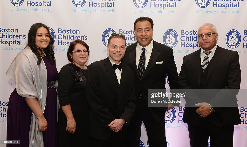 John Quinones (2nd R) attends the 4th Annual Milagros para Ninos Gala benefitting Boston Children's Hospital with Eduardo Martinez, Jr. family at The Westin Boston Waterfront on September 20, 2013 in Boston, Massachusetts.