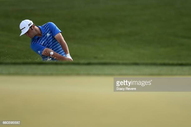 John Rahm of Spain hits from a greenside bunker on the 13th hole during the first round of the Shell Houston Open at the Golf Club of Houston on...