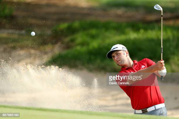 John Rahm of Spain plays his second shot on the par 3 seventh hole in his match against Bill Haas during the semifinal of the 2017 Dell Match Play at...