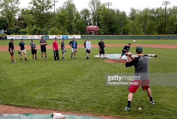 John Raiola right pitching coach for the Sanford Mainers hits ground balls to his pitchers as part of pitcher fielding drills at Goodall Park in...