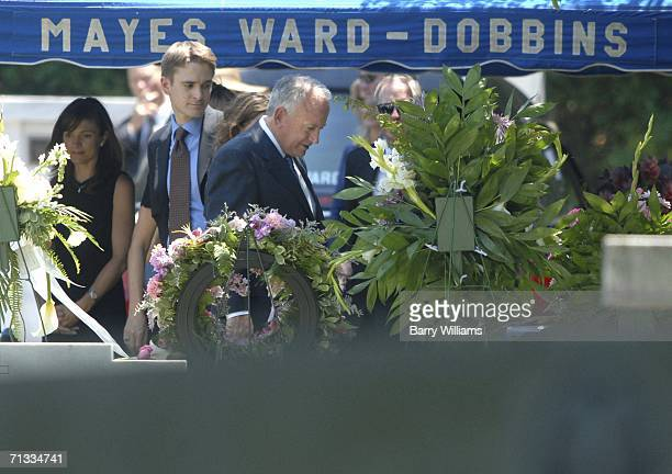 John Ramsey looks over the grave of his daughter JonBenet Ramsey after the graveside service of his wife Patsy Ramsey June 29 2006 in Marietta...