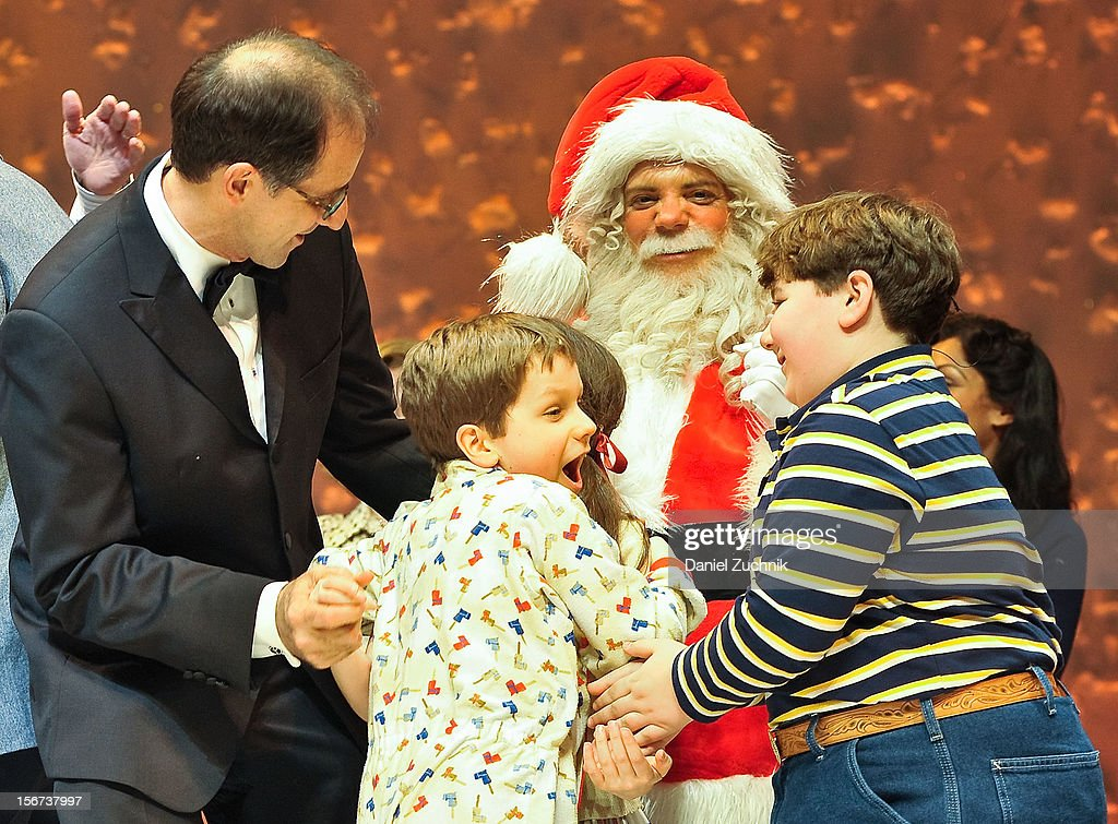 John Rando(L), Zac Ballard(C) and cast perform during 'A Christmas Story: The Musical' broadway opening at Lunt-Fontanne Theatre on November 19, 2012 in New York City.
