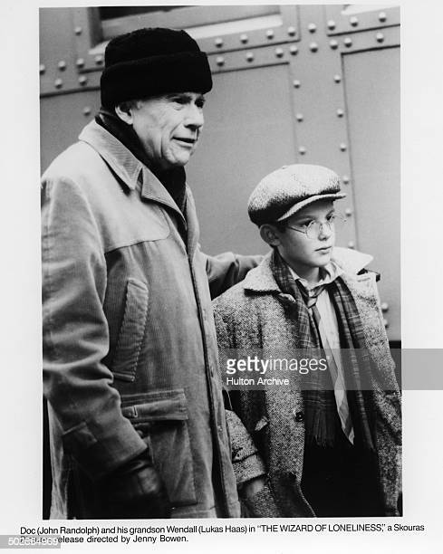 John Randolph walks with Lukas Haas in a scene from the movie 'The Wizard of Loneliness' circa 1988