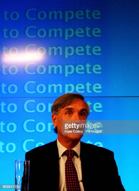John Redwood MP looks on as Shadow Chancellor of the Exchequer George Osborne comments on the Economic Competitiveness Policy Group Report