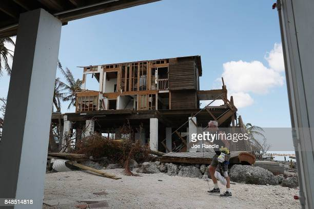 John Rhode attempts to salvage what he can from his home that was destroyed by hurricane Irma on September 17 2017 in Summerland Key Florida The...