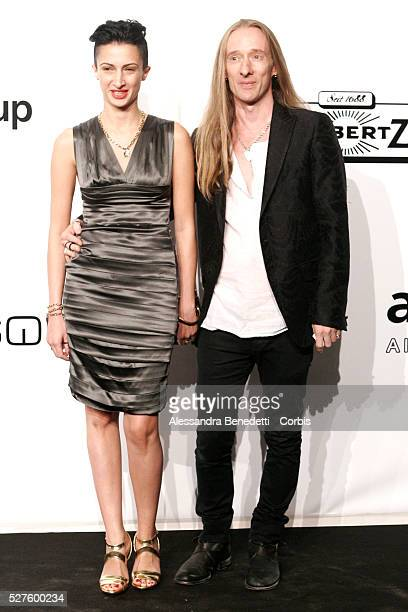 John Richmond and guest on the AmfAR Milano 2009 red carpet during the inaugural Milan Fashion Week event at La Permanente