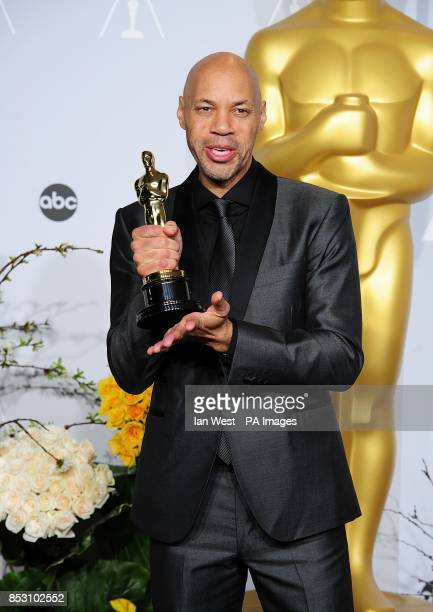 John Ridley in the press room with hs award for Best Adapted Screenplay received for '12 Years a Slave' at the 86th Academy Awards held at the Dolby...