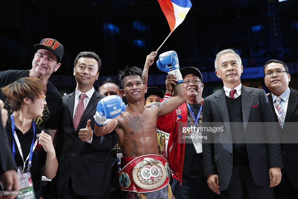 John riel Casimero of Philippines celebrates after victory over Amnat Ruenroeng of Thailand during the IBF World Boxing Championship at Beijing Olympic park diamond stadium on May 25, 2016 in Beijing, China.