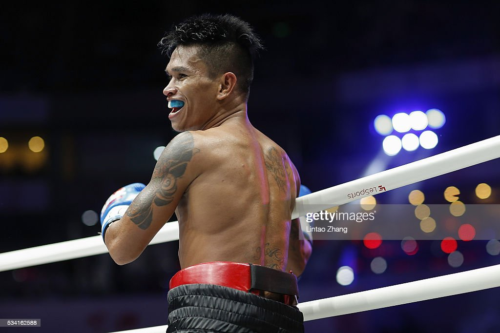 John riel Casimero of Philippines celebrates his victory over Amnat Ruenroeng of Thailand during the IBF World Boxing Championship at Beijing Olympic park diamond stadium on May 25, 2016 in Beijing, China.