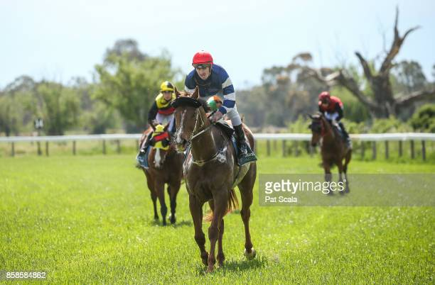 John Robertson returns to the mounting yard on Harlem Star after winning Cohuna IGA BM52 HandicapGunbower Racecourse on October 07 2017 in Gunbower...