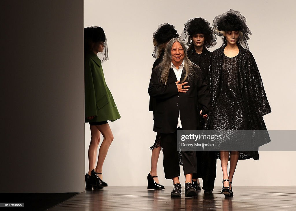 John Rocha walks the runway with models at his John Rocha show during London Fashion Week Fall/Winter 2013/14 at Somerset House on February 16, 2013 in London, England.
