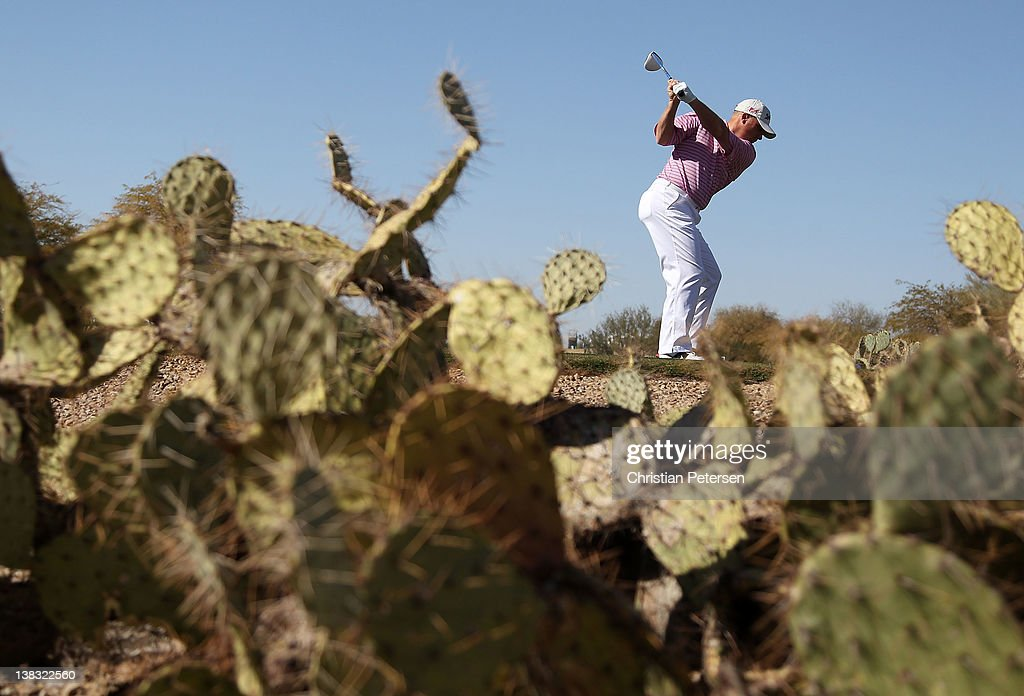 <a gi-track='captionPersonalityLinkClicked' href=/galleries/search?phrase=John+Rollins&family=editorial&specificpeople=228129 ng-click='$event.stopPropagation()'>John Rollins</a> hits a tee shot on the 11th hole during the final round of the Waste Management Phoenix Open at TPC Scottsdale on February 5, 2012 in Scottsdale, Arizona.
