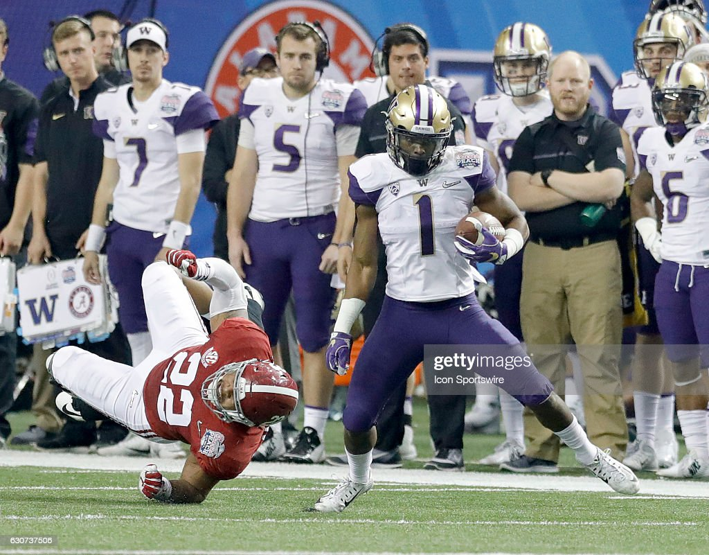 John Ross (1) evades a tackle during the Chick-fil-A Peach Bowl game between the Alabama Crimson Tide and the Washington Huskies on December 31, 2016, at the Georgia Dome in Atlanta, GA.
