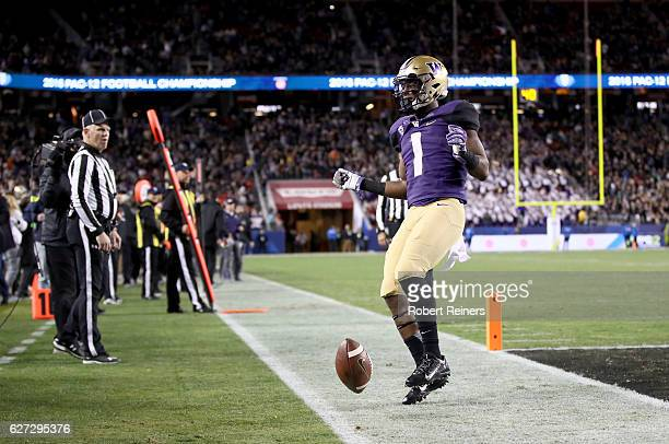 John Ross of the Washington Huskies reacts after scoring a touchdown against the Colorado Buffaloes during the Pac12 Championship game at Levi's...