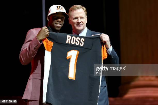John Ross of Washington poses with Commissioner of the National Football League Roger Goodell after being picked overall by the Cincinnati Bengals...