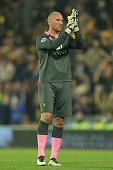 John Ruddy of Norwich City applauds the fans after his side was relegated during the Barclays Premier League match between Norwich City and Watford...