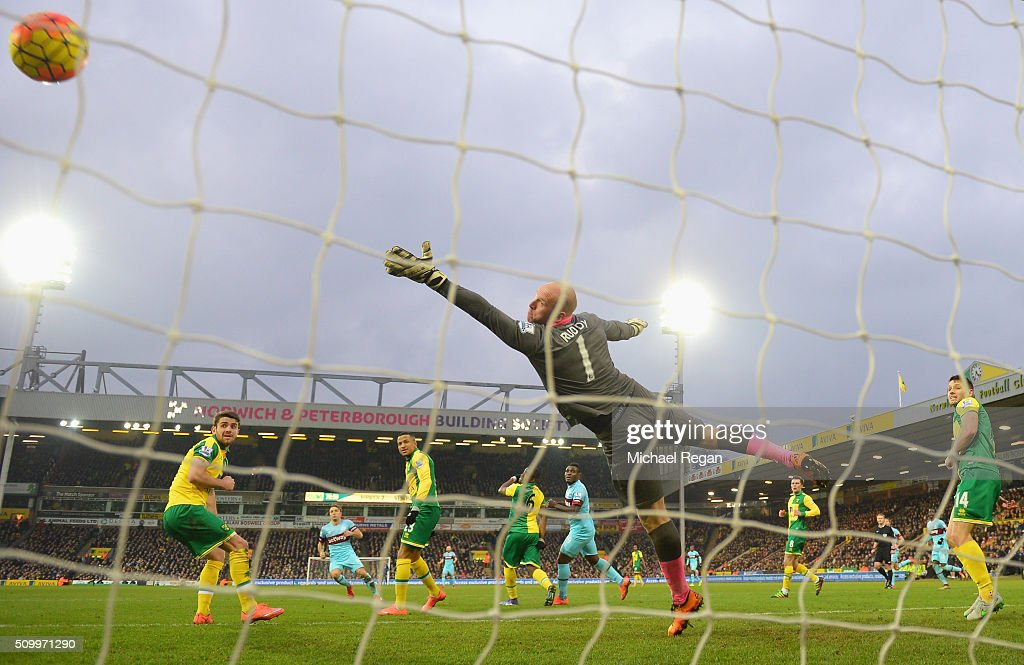 John Ruddy of Norwich City dives in vain as Mark Noble (2nd L) of West Ham United scores his team's second goal during the Barclays Premier League match between Norwich City and West Ham United at Carrow Road on February 13, 2016 in Norwich, England.
