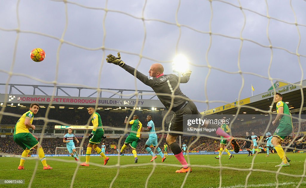 <a gi-track='captionPersonalityLinkClicked' href=/galleries/search?phrase=John+Ruddy&family=editorial&specificpeople=822348 ng-click='$event.stopPropagation()'>John Ruddy</a> of Norwich City dives in vain as <a gi-track='captionPersonalityLinkClicked' href=/galleries/search?phrase=Mark+Noble&family=editorial&specificpeople=844055 ng-click='$event.stopPropagation()'>Mark Noble</a> (2nd L) of West Ham United scores his team's second goal during the Barclays Premier League match between Norwich City and West Ham United at Carrow Road on February 13, 2016 in Norwich, England.