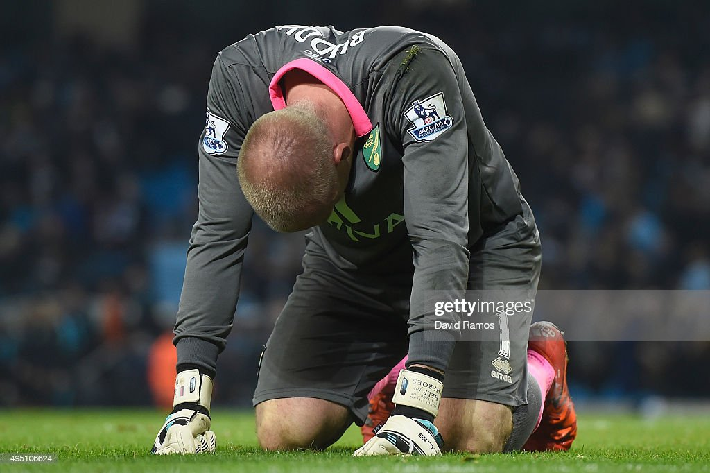 John Ruddy of Norwich City reacts after saving a penalty by Aleksandar Kolarov of Manchester City during the Barclays Premier League match between Manchester City and Norwich City at Etihad Stadium on October 31, 2015 in Manchester, England.