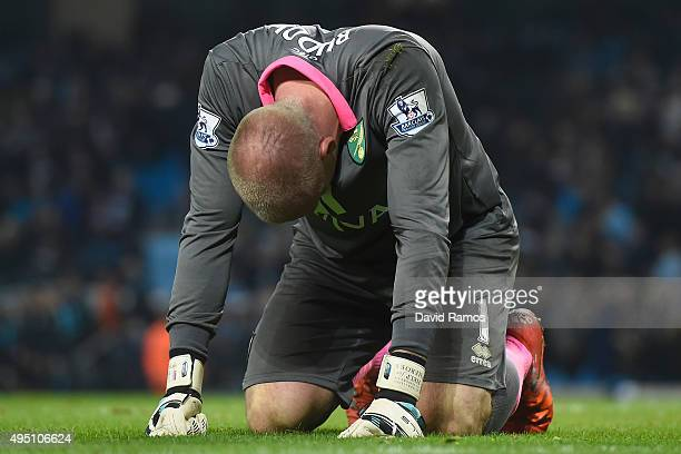 John Ruddy of Norwich City reacts after saving a penalty by Aleksandar Kolarov of Manchester City during the Barclays Premier League match between...