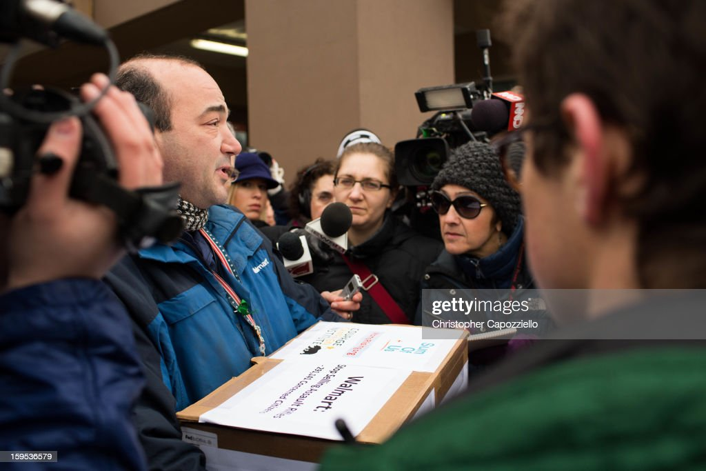 John Ruggieri, manager of the Walmart in Danbury, Conn., received petitions and letters victims of gun violence from protestors outside the Danbury Walmart January 15, 2013 in Danbury, Connecticut. Gun control advocates along with parents of victims and gun violence survivors joined together to urge Walmart, the nation's largest gun retailer to stop the sale of assault weapons and munitions in their stores nationwide.