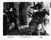 John Russell raising gun at swordsmen in a scene from the film 'Forever Amber' 1947