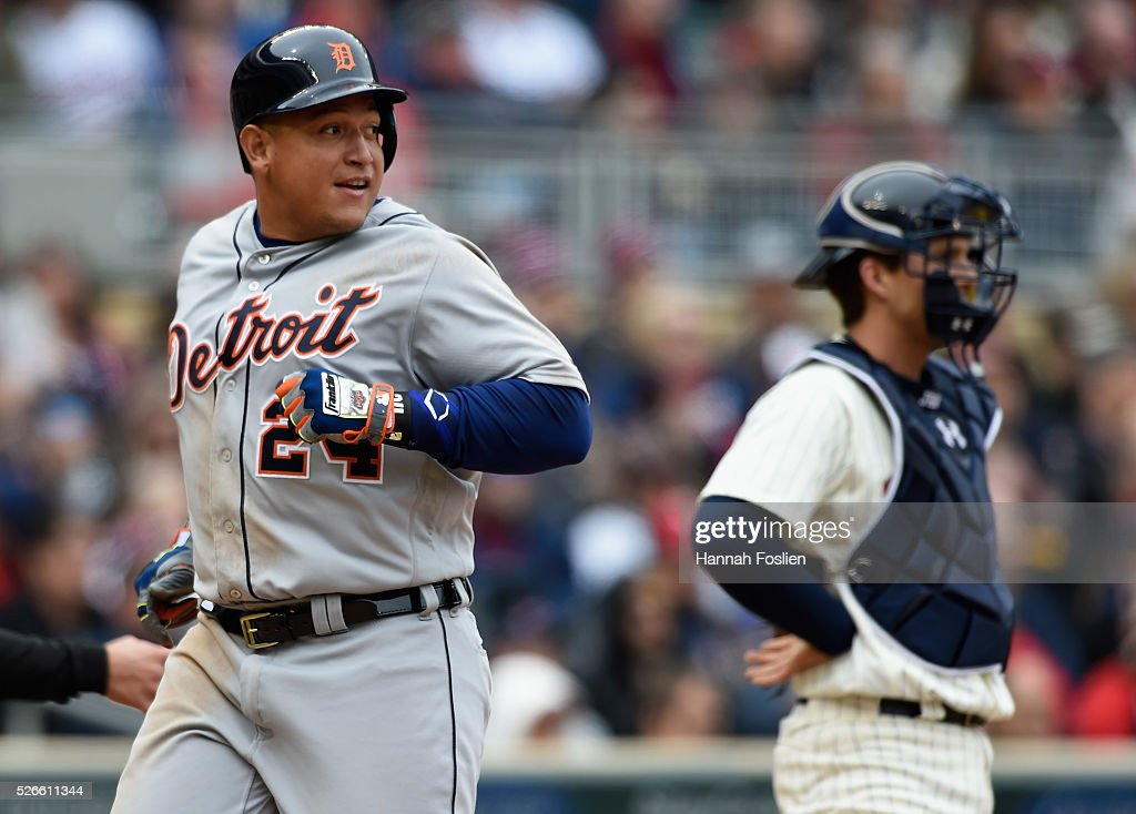 John Ryan Murphy #12 of the Minnesota Twins looks on as <a gi-track='captionPersonalityLinkClicked' href=/galleries/search?phrase=Miguel+Cabrera&family=editorial&specificpeople=202141 ng-click='$event.stopPropagation()'>Miguel Cabrera</a> #24 of the Detroit Tigers crosses home plate to score a run after an RBI double by teammate Victor Martinez #41 during the sixth inning of the game on April 30, 2016 at Target Field in Minneapolis, Minnesota. The Tigers defeated the Twins 4-1.