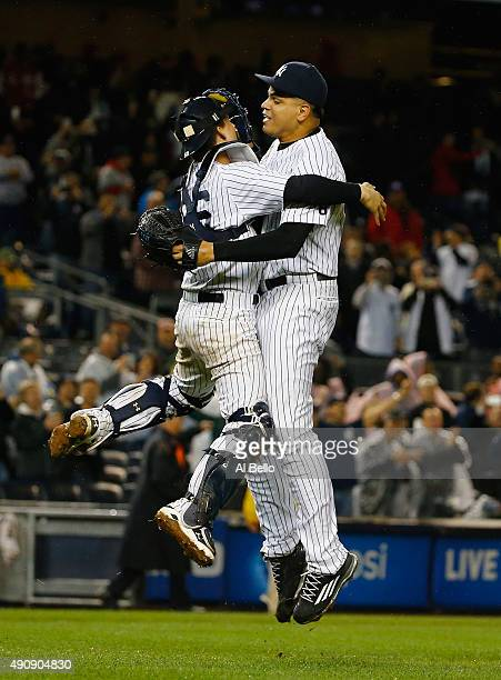 John Ryan Murphy of the New York Yankees and Dellin Betances celebrate the New York Yankees 10000th win and their wildcard clinching berth to the...