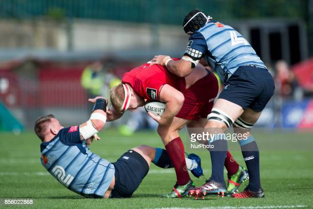 John Ryan of Munster tackled by Matthew Rees and George Earle of Cardiff during the Guinness PRO14 Conference A Round 5 match between Munster Rugby...