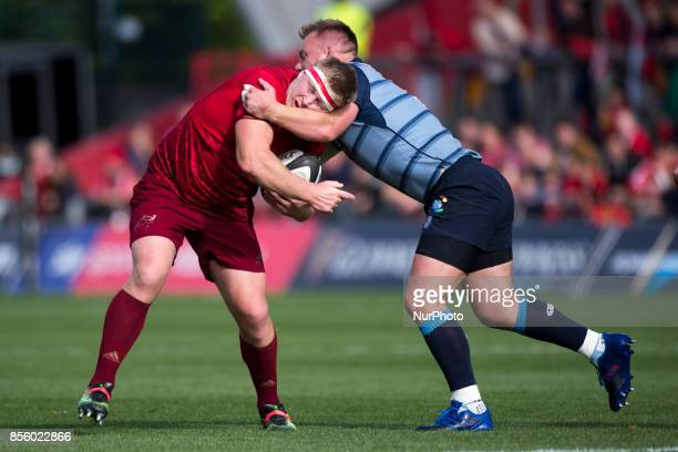 John Ryan of Munster tackled by Matthew Rees of Cardiff during the Guinness PRO14 Conference A Round 5 match between Munster Rugby and Cardiff Blues...