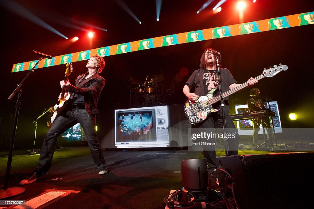 John Rzeznik (lead singer) and bassist Robby Takac of Goo Goo Dolls perform at Gibson Amphitheatre on July 17, 2013 in Universal City, California.