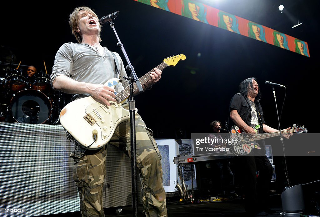 <a gi-track='captionPersonalityLinkClicked' href=/galleries/search?phrase=John+Rzeznik&family=editorial&specificpeople=220876 ng-click='$event.stopPropagation()'>John Rzeznik</a> (L) and <a gi-track='captionPersonalityLinkClicked' href=/galleries/search?phrase=Robby+Takac&family=editorial&specificpeople=778886 ng-click='$event.stopPropagation()'>Robby Takac</a> of Goo Goo Dolls perform in support of the bands' Magnetic release at Sleep Train Pavilion on July 23, 2013 in Concord, California.