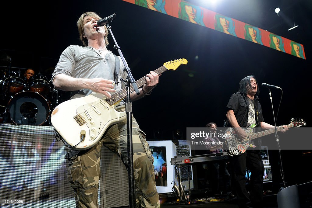 John Rzeznik (L) and Robby Takac of Goo Goo Dolls perform in support of the bands' Magnetic release at Sleep Train Pavilion on July 23, 2013 in Concord, California.