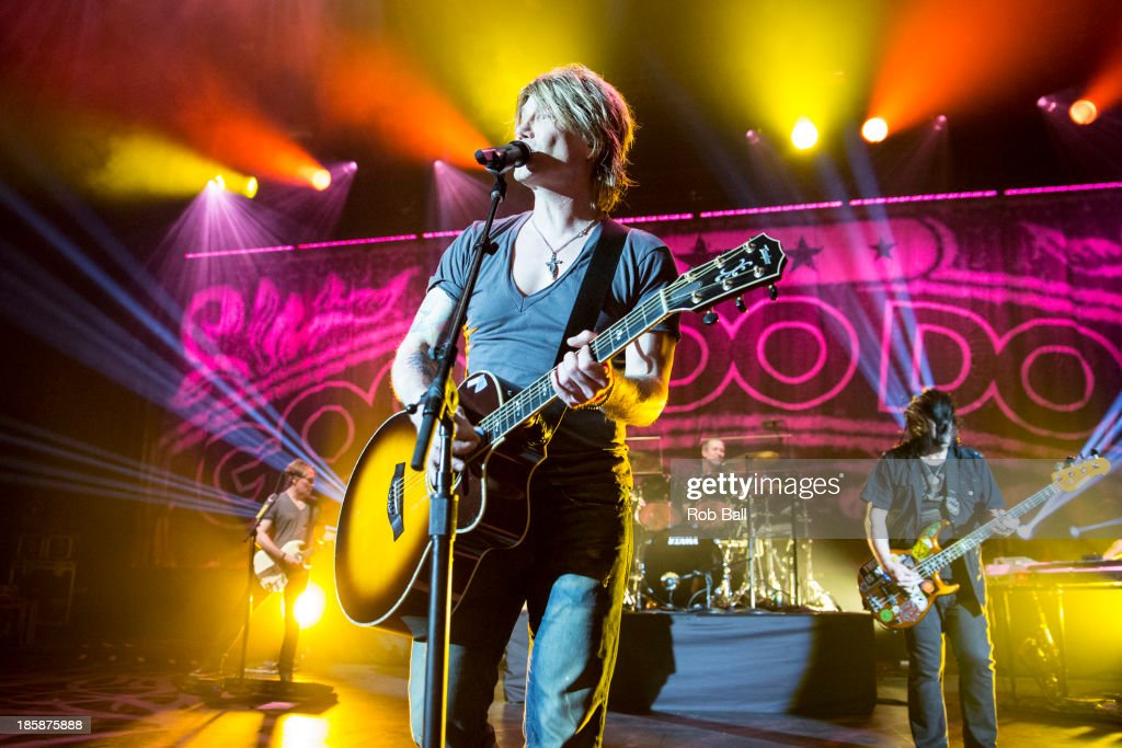 John Rzeznik and Robby Takac of Goo Goo Dolls performs on stage at Hammersmith Apollo on October 25, 2013 in London, England.