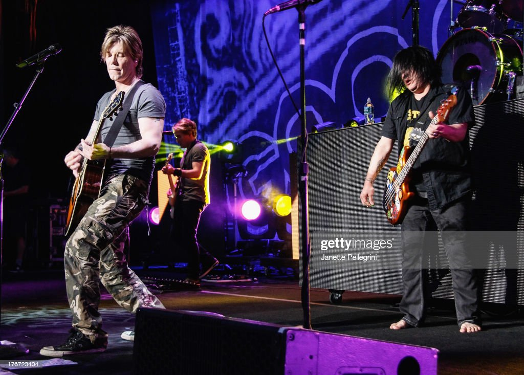 John Rzeznik and Robby Takac of the Goo Goo Dolls perform at Nikon at Jones Beach Theater on August 17, 2013 in Wantagh, New York.