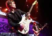 John Rzeznik and Robby Takac of the Goo Goo Dolls perform onstage at Gibson Amphitheatre on July 17 2013 in Universal City California