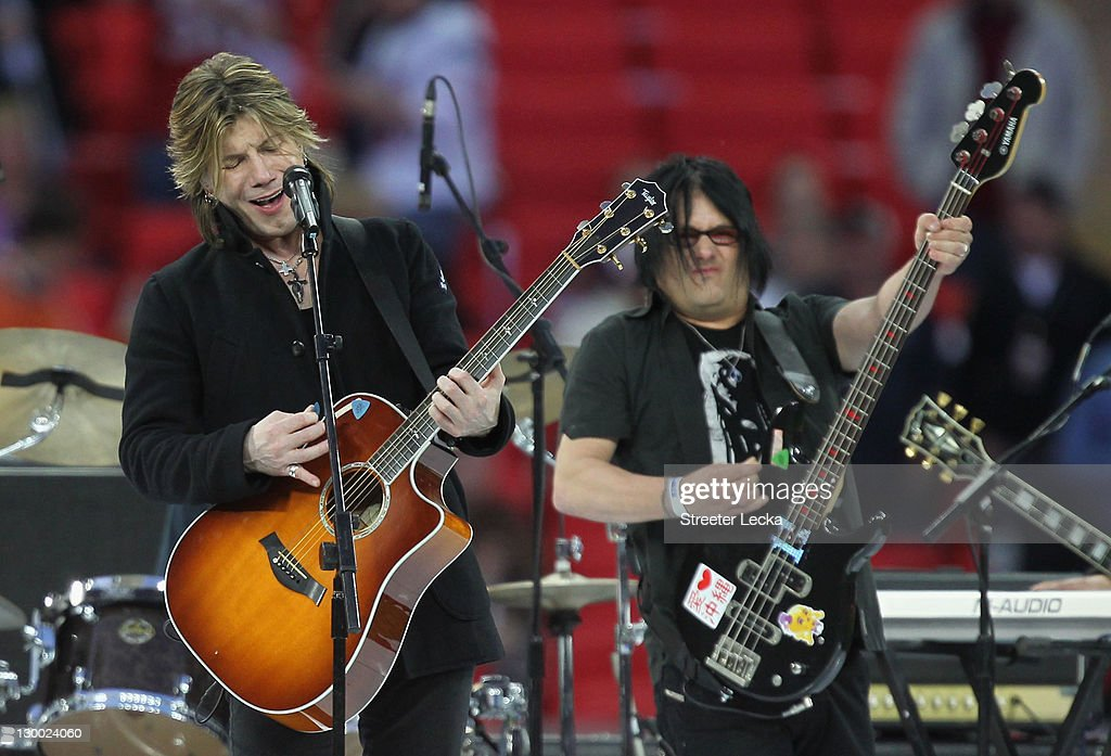 John Rzeznik (L) and Robby Takac (R) of the Goo Goo Dolls perform the pregame entertainment prior to the NFL International Series match between Chicago Bears and Tampa Bay Buccaneers at Wembley Stadium on October 23, 2011 in London, England. This is the fifth occasion where a regular season NFL match has been played in London.