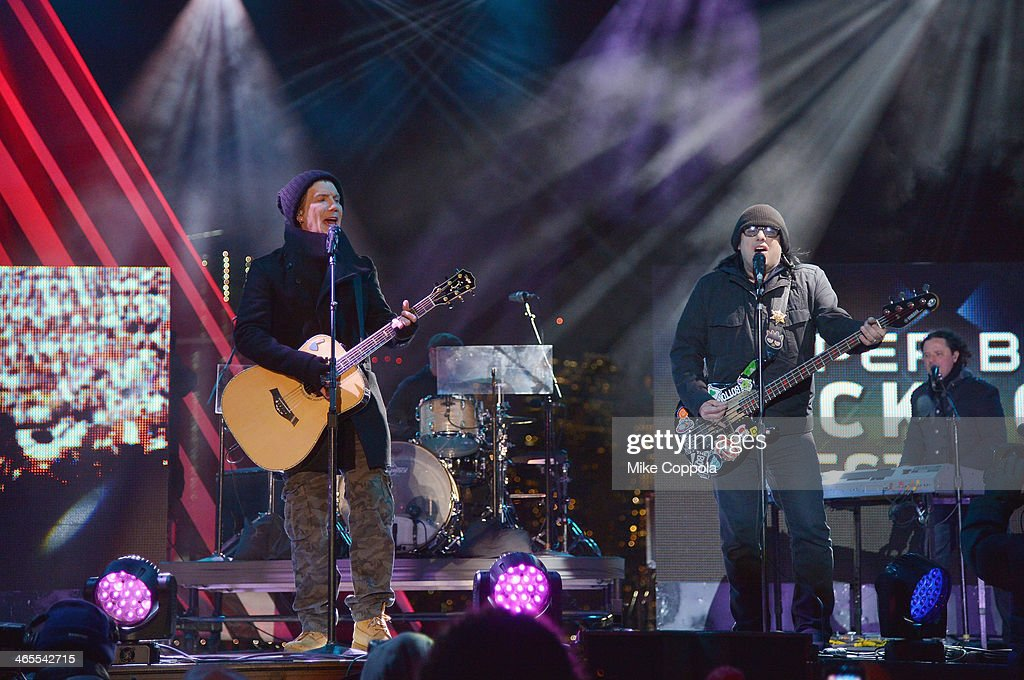 John Rzeznik (L) and Robby Takac of the rock band the Goo Goo Dolls perfoms at the Super Bowl Kickoff Spectacular at Liberty State Park on January 27, 2014 in Jersey City, New Jersey.