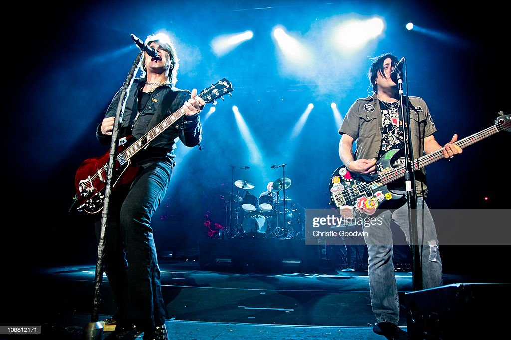 John Rzeznik, Mike Malinin and Robby Takac of Goo Goo Dolls perform at Brixton Academy on November 13, 2010 in London, England.