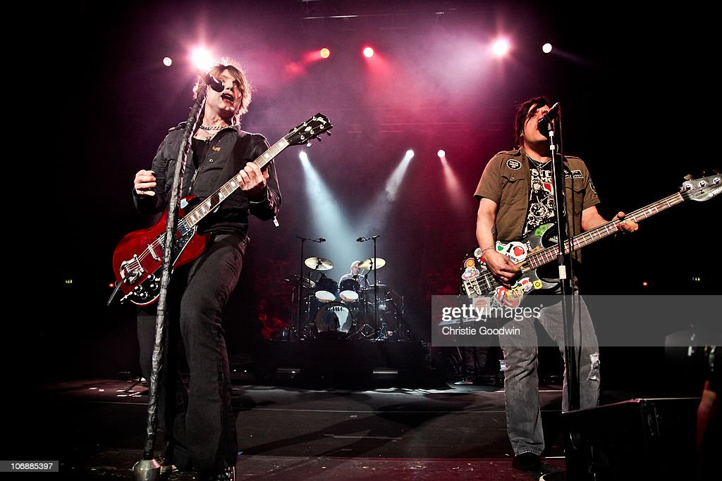 John Rzeznik, Mike Malinin and Robby Takac of Goo Goo Dolls perform on stage at Brixton Academy on November 13, 2010 in London, England.