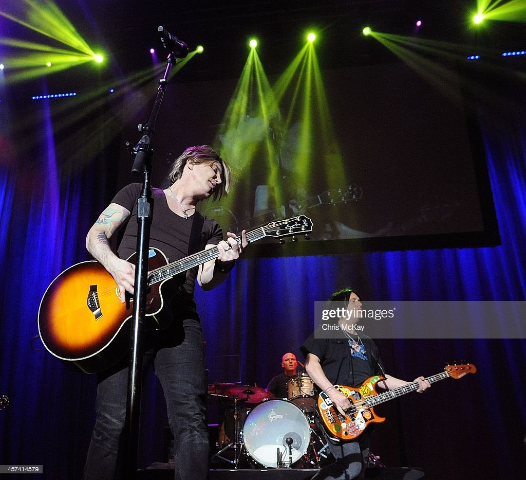John Rzeznik, Mike Malinin, and Robby Takac of Goo Goo Dolls perform during the 2013 Star 94 Jingle Jam at Arena at Gwinnett Center on December 16, 2013 in Duluth, Georgia.