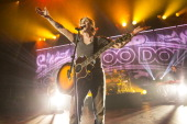 John Rzeznik of Goo Goo Dolls performs on stage at Hammersmith Apollo on October 25 2013 in London England
